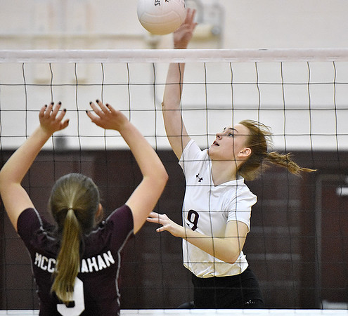 (Brad Davis/The Register-Herald) Woodrow Wilson's Sophie Booth hits the ball as George Washington's Julia McClanahan defends during the Class AAA Regional Volleyball tournament Saturday afternoon in Beckley.
