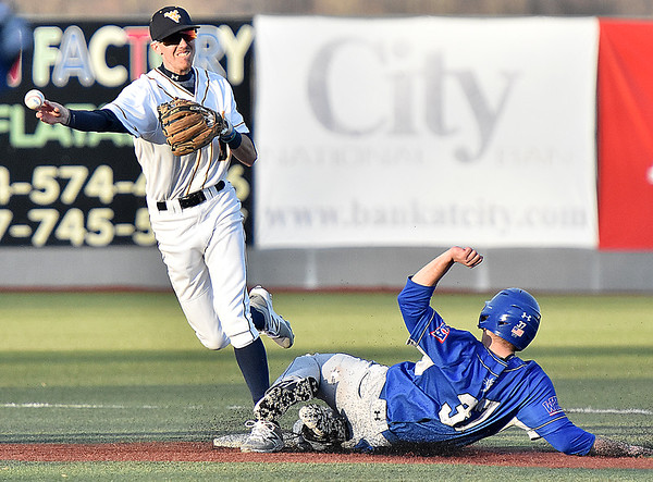 (Brad Davis/The Register-Herald) WVU Tech 2nd baseman Sean Crosby forces out Lawrence Tech baserunner Joseph Russo as he turns a double play Sunday afternoon at Linda K. Epling Stadium.