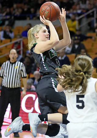 (Brad Davis/The Register-Herald) Wyoming East's Misa Quesenberry drives and scores as North Marion's Taylor Buonamici defends Saturday afternoon at the Charleston Civic Center.