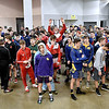 (Brad Davis/The Register-Herald) indy wrestler Liam Lusher (jumping) makes sure the camera sees him amongst a sea of remaining champions from across the state as they gather in the staging area for the champions march during State Wrestling Tournament action Saturday night at the Big Sandy Arena.