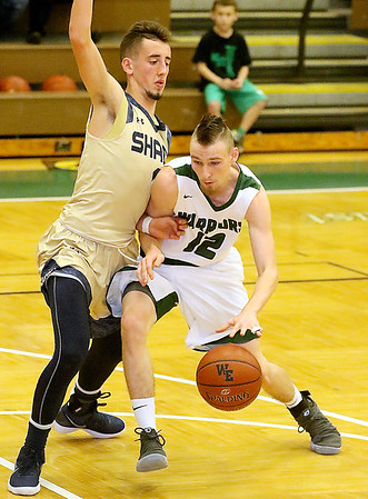 (Brad Davis/The Register-Herald) Wyoming East's R.J. Hood lowers his shoulder and starts a drive into the lane as Shady Spring's Cole Honaker defends Friday night in New Richmond.