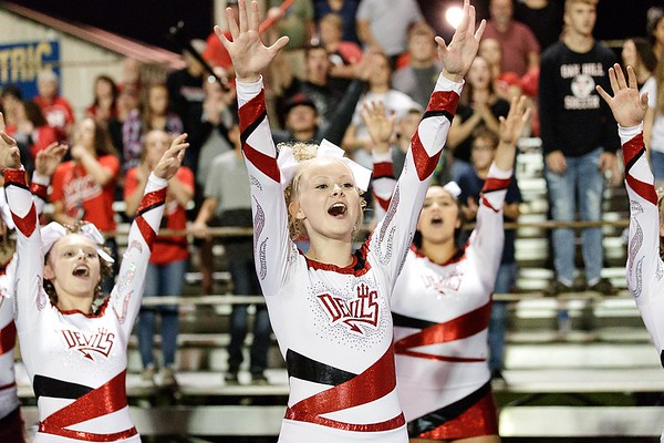 Oak Hill cheerleaders and fans get excited after the Red Devils make a big play. Chad Foreman for the Register-Herald.