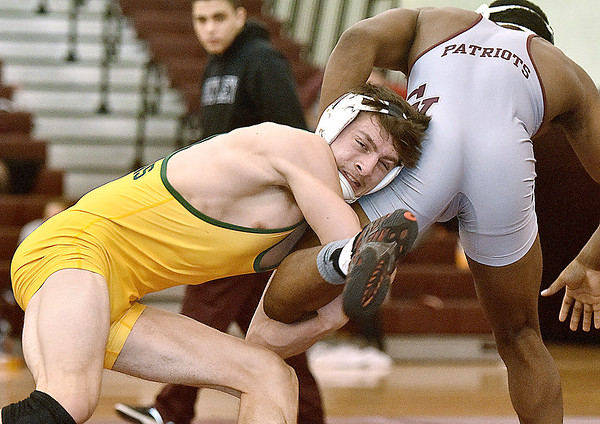 (Brad Davis/The Register-Herald) Greenbrier East's Jacob Hefner takes on George Washington's Jayvon Hall in a 160-pound weight class matchup during the Class AAA Regionals Saturady afternoon at Woodrow Wilson High School. East's Hefner won the match.