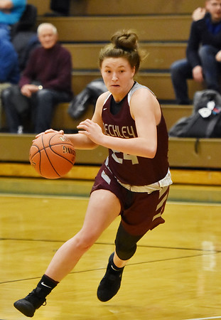 Woodrow Wilson's Elizabeth Cadle drives to the basket during their basketball game against Wyoming East Wednesday in New Richmond. (Chris Jackson/The Register-Herald)