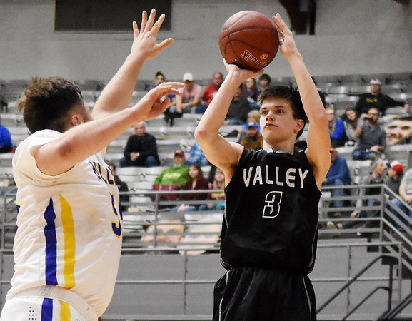 Valley's Spencer Dean (3) puts up a jumper early in the fourth quarter over Van's Brandon Moore (55) during their Big Atlantic Classic Tournament Monday in Beckley. Dean finished the game with 25 points in their 69-59 win. (Chris Jackson/The Register-Herald)