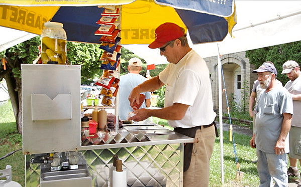 Dave Joyce attends to the lunch crowd at his hot dog stand in Renick. (Jenny Harnish/The Register-Herald)