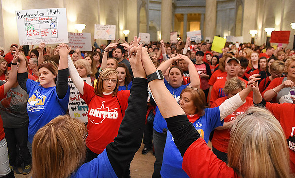 Teachers, service personnel and students join hands in front of the Senate Chambers floor in the State Capitol rallying during the seventh day of their walkout.<br /> (Rick Barbero/The Register-Herald)