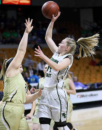 (Brad Davis/The Register-Herald) Wyoming East's Jazz Blankenship drives and scores as Lincoln's Brynne Williams defends Wednesday afternoon at the Charleston Civic Center.