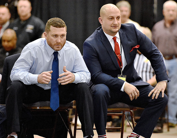 (Brad Davis/The Register-Herald) Indy coaches Jeremy Hart, left, and Jamie Bolen watch their wrestlers during State Wrestling Tournament action Saturday night at the Big Sandy Arena.