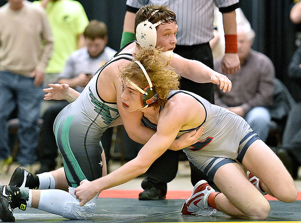 (Brad Davis/The Register-Herald) Independence's Alex Hart takes on Winfield's Jamie Ward for the Class AA/A 145-pound championship during State Wrestling Tournament action Saturday night at the Big Sandy Arena. Winfield's Ward won the match.