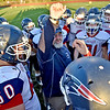 (Brad Davis/The Register-Herald) Head coach John Lilly fires up his Patriots prior to a road game at Shady Spring Thursday night.