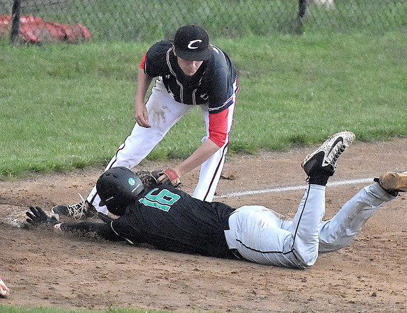 (Brad Davis/The Register-Herald) Greater Beckley Christian 3rd baseman Cole Kipps tags out Charleston Catholic baserunner Timothy Kawash during a wild game in Beckley Tuesday evening.