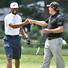 (Brad Davis/The Register-Herald) Pro-Am groupmate Larry Fitzgerald, left, and Phil Mickelson bump fists after seasoned PGA Tour pro Mickelson continued to wow the crowd and Fitzgerald, a pretty good golfer himself, with his laser sharp putting accuracy during Wednesday's action in White Sulphur Springs.