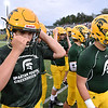 (Brad Davis/The Register-Herald) Greenbrier East players get ready during warmups Friday night in Fairlea.