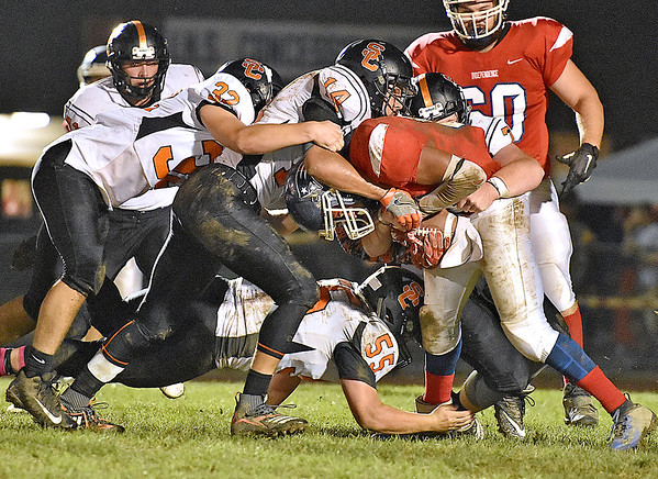 (Brad Davis/The Register-Herald) Independence's Nico Burgess is gang tackled by the Summers County defense Friday night in Coal City.