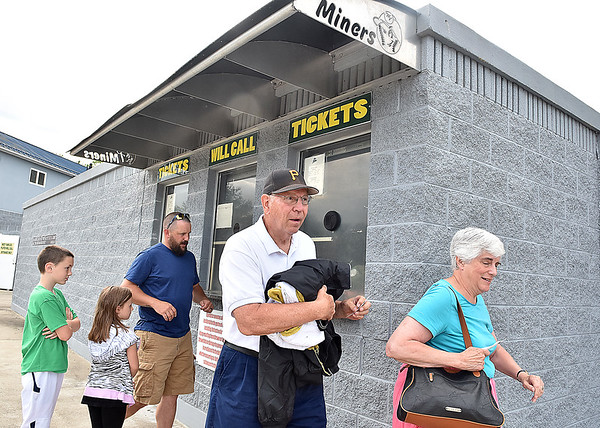 (Brad Davis/The Register-Herald) St. Albans residents Peg, far right, and Bob Henrich, grandparents of West Virginia Miners pitcher Austin Henrich, head for the gate after picking up tickets at the box office prior to the start of the team's season opener against the Kokomo Jackrabbits Wednesday evening at Linda K. Epling Stadium.