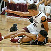 (Brad Davis/The Register-Herald) Woodrow Wilson's Eddie Christian ends up on top of Bluefield's Dominick Taxley as the two collide at mid court while diving for a loose ball during the Little General Battle for the Armory Tournament Thursday night at the Beckley-Raleigh County Convention Center.