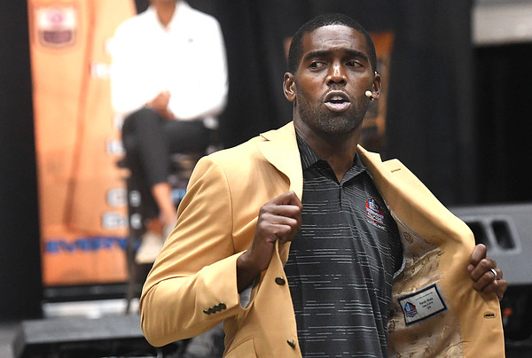 NFL Pro Football Hall of Fame Randy Moss, sports his gold Hall of Fame jacket during the Youth Summit held at the Beckley-Raleigh Convention Center Friday morning.<br /> (Rick Barbero/The Register-Herald)