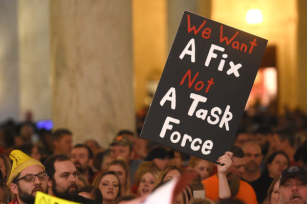Teachers and service personnel rally in front of the Senate Chambers at the State Capitol in Charleston during Day 6 of the teachers walkout.<br /> (Rick Barbero/The Register-Herald)