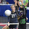 (Brad Davis/The Register-Herald) Nicholas County's Anna Hamilton rips a spike past Winfield's Jordan Signorelli during State Volleyball Tournament action Friday afternoon at the Charleston Civic Center.