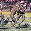 (Brad Davis/The Register-Herald) Meadow Bridge ball carrier Caleb Richmond trudges through the mud for a 3rd quarter touchdown run Friday night in Meadow Bridge.
