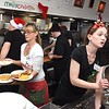 Shirley Thomas, left, and Felicia Robertson, servers at Omelette Shop Harper Road in Beckley, working on Christmas day.<br /> (Rick Barbero/The Register-Herald)