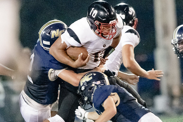 Oak Hill Quarterback, Khori Bass pushes forward through the Nicholas County defense to pick up a few more yards. Chad Foreman for the Register-Herald.