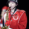 An Oak Hill Marching Red Devil is blowing on the saxophone. Chad Foreman for the Register-Herald.