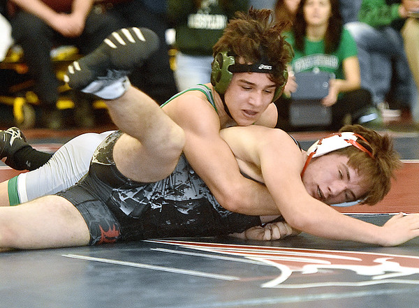 (Brad Davis/The Register-Herald) Fayetteville's Eli Sedlock takes on Liberty's Billy Stoots in a 138-pound weight class matchup during the Class AA/A Regionals Saturday afternoon at Independence High School. Fayetteville's Sedlock won the match.