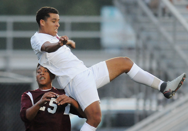 Woodrow's Tyler Miller (25) goes up for a challenge with George Washington's Zak Abdul-Jalil (18) during their soccer match Thursday in Beckley. (Chris Jackson/The Register-Herald)