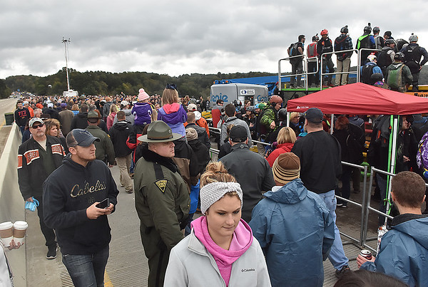 (Brad Davis/The Register-Herald) The crowd gathers around the platform area during Bridge Day Saturday morning in Fayetteville.