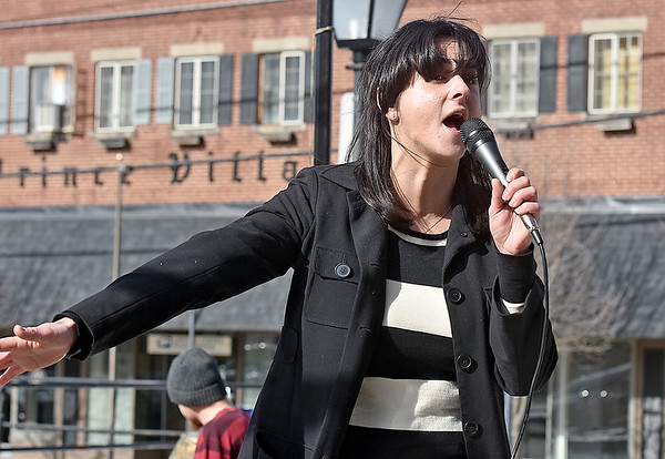 "(Brad Davis/The Register-Herald) Alexandra Gallo, Development Director at the West Virginia Citizens Action Group, delivers a speech to the large crowd on hand during the ""It's Our Time"" rally marking the one-year anniversary of the Women's March Saturday morning in Beckley's Showmaker Square."