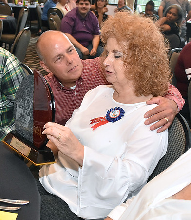 (Brad Davis/The Register-Herald) Co-owner Tim Harper thanks longtime, retiring Plaza McDonald's employee Mary Garris after presenting her with an award for service September 15 at Black Knight.