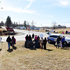Dozens of people line Rt. 219 and the entrance to the Lewisburg Airport during the Protest, March & Rally, hosted by Greater Greenbrier Valley Indivisible and Women's March, at the entrance waiting the arrival of the Republican members of congress for their retreat at The Greenbrier Resort Wednesday in Lewisburg. (Chris Jackson/The Register-Herald)