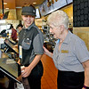(Brad Davis/The Register-Herald) Retiring McDonald's manager Jessie Wolfe with employee Dasha Maynard during a Register-Herald visit to her store Wednesday afternoon.