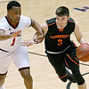 (Brad Davis/The Register-Herald) Summer County's Cordell Meadows tries to drive around Greater Beckley Christian's Caleb Clark as he moves the ball across mid-court Friday night at the Beckley-Raleigh County Convention Center.
