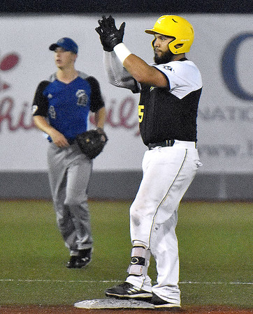 (Brad Davis/The Register-Herald) Miners player Jonathan Pasillas claps towards cheering teammates in the dugout after hitting a double, sending teammate Dalton Cornett to 3rd in what would be a 2-run 2nd inning against Terre Haute Wednesday night at Linda K. Epling Stadium.