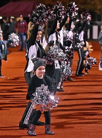(Brad Davis/The Register-Herald) Aspiring young dancers mimic the moves of their high school counterparts as they join the Flying Eagle dance team on the line Friday night in Beckley.