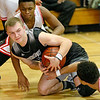 (Brad Davis/The Register-Herald) Westside's Jacob Ellis grapples for a loose ball underneath the basket with Oak Hill's Jason Manns, left, and Abraham Farrow Friday night in Oak Hill.