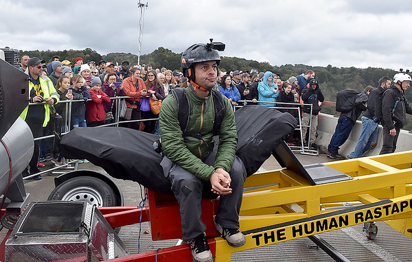 """(Brad Davis/The Register-Herald) Venezuelan B.A.S.E. jumper Johnny Sanchez patiently waits for his turn to be launched from the deck via """"the human rastapult"""" during Bridge Day Saturday morning in Fayetteville."""