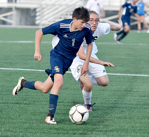 (Brad Davis/The Register-Herald) Shady Spring's Walker Bowman holds off Bluefield's Christian Lowe as he dribbles the ball Thursday evening at the YMCA Paul Cline Memorial Sports Complex.