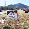 Banners showing opposition to the GOP legislators that are attending a Republican Party retreat at The Greenbrier Resort line U.S. 60 in White Sulphur Springs on Wednesday. (Chris Jackson/The Register-Herald)