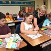 Kattie Cooper, third grade teacher Crescent Elementary School in Beckley, third from left, works with her new students, Joey DellaMea, left, Audrey Murphy and Ethan Scott, during the first day of school in Raleigh County.<br /> (Rick Barbero/The Register-Herald)