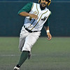 (Brad Davis/The Register-Herald) Miners baserunner DePaul Blunt speeds around 3rd base to score off teammate Mike Santaromita's 2nd inning double Wednesday night at Linda K. Epling Stadium.