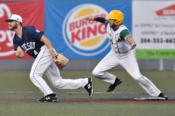(Brad Davis/The Register-Herald) Miners baserunner Cole Coffey breaks towards 3rd base but would stay at 2nd after the ball got past Butler shortstop Jeffrey Wehler, left, due to an errant throw by 2nd baseman Dominick Bucko on a ground ball from Miners hitter Jonathan Pasillas Wednesday night at Linda K. Epling Stadium.