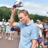 (Brad Davis/The Register-Herald) David Bradshaw acknowledges the crowd as he steps out to receive the trophy after winning the 2018 West Virginia Open Friday afternoon at Glade Springs' Cobb Course.