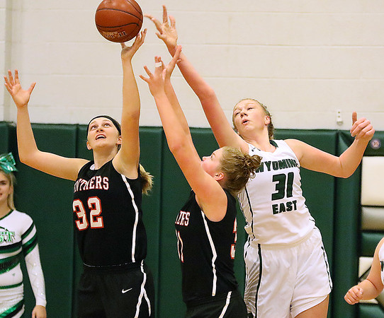 (Brad Davis/The Register-Herald) PikeView's Laken McKinney, left, and Shiloh Bailey battle for an offensive rebound with Wyoming East center Emily Saunders Thursday night in New Richmond.