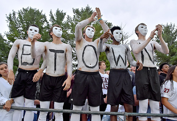 (Brad Davis/The Register-Herald) A group of Woodrow Wilson students get rowdy Friday night in Fairlea.