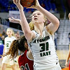 (Brad Davis/The Register-Herald) Wyoming East's Emily Saunders scores as Wayne's Nakayla Elliot defends Friday morning at the Charleston Civic Center.