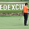 Bubba Watson, left, talks with his caddie on the par 3, 18th green during the first round of, A Military Tribute at The Greenbrier golf tournament.<br /> (Rick Barbero/The Register-Herald)